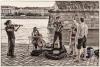 pouliční umělci na náplavce v Praze
